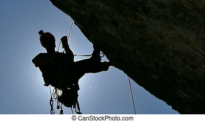 Silhouette of a Rock Climber - Rock Climber Climbing the...