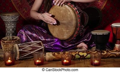 Caucasian woman playing drum indoor - Tilt up video shot of...