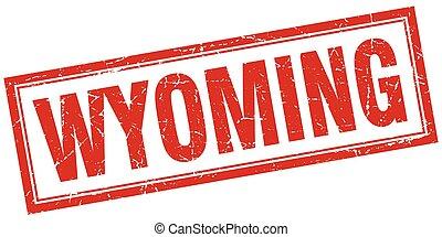 Wyoming red square grunge stamp on white