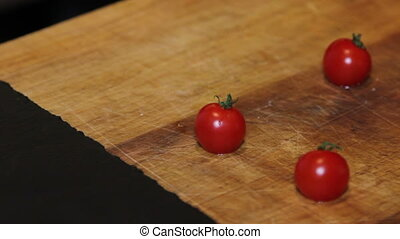 small tomato at kitchen table. zooming shot