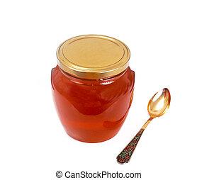 Jar with honey Isolated on White Background.