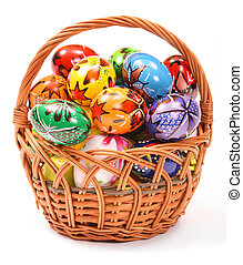 Easter Eggs in wicker basket - Couple of colorful Easter...
