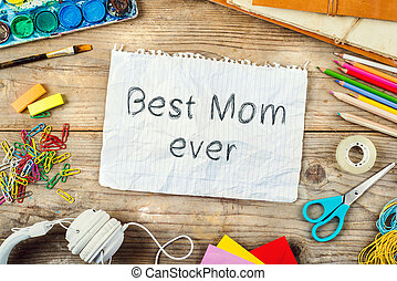 Mothers day composition Best mom ever sign Wooden background...