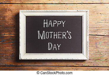 Mothers day composition. Picture frame. Wooden background....