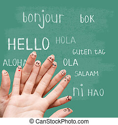 Hello in various languages on chalkboard - Hello in various...