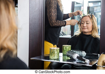 Woman Getting New Hairstyle In Parlor - Mature woman getting...