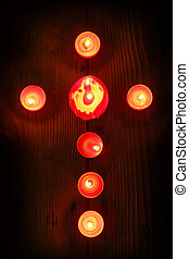 candles in a cross - burning candles arranged in a cross