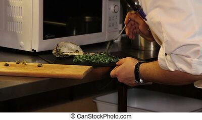 chef cooking caper sauce for salmon - cooking caper sauce...