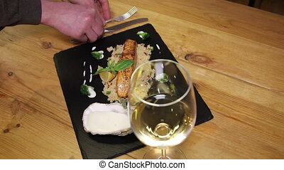 serving dish with knife and fork - serving dish of salmon...