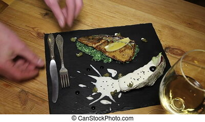 fish with spinach and capers sauce - tasty dish in...
