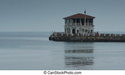 House coast shore Istanbul - Coast with calm waves and house...