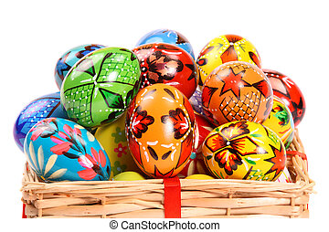Couple of colorful Easter Eggs in a yellow basket.