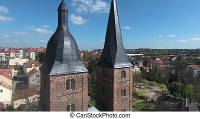 areial view to the two red towers in the medieval town...