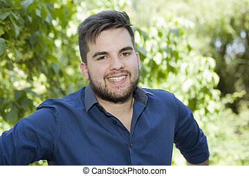 casual man - happy young casual man outdoor portrait