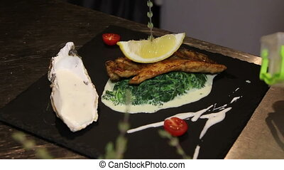 decoration of fish with spinach and capers sauce - tasty...