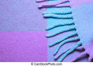 Soft and warm folded alpaca wool blanket with fringe. Blue...
