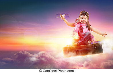 Child Flying With Fantasy On Suitcase In The Sky