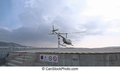 Helicopter taking off from platform