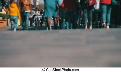 Anonymous People Walking on the Street. Defocused. Crowd...