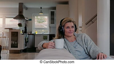 happy woman relaxing and listening to music - Contented...