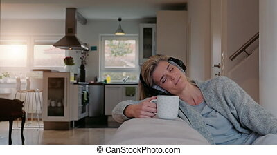 Contented woman relaxing listening to music