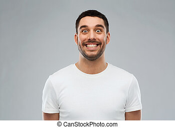 man with funny face over gray background - expression and...