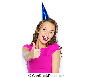 happy young woman or teen girl in party cap - people,...