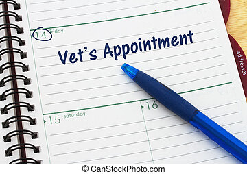 Scheduling your vet's appointment, a day planner with blue...