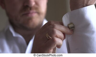 Man wears white shirt and cufflinks - Man wears white shirt...