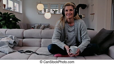 Attractive woman relaxing listening to music