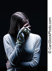 I cant stand myself - Bulimic woman covering face with one...