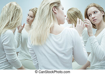 Suffering from a serious mental disorder - Young woman in...