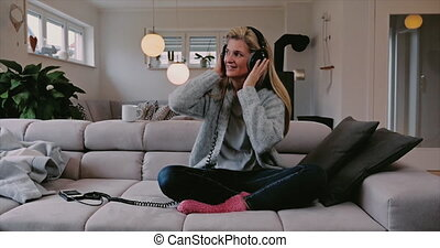 Smiling happy woman with headphones - Smiling happy woman...