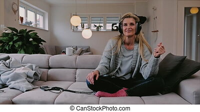 Smiling happy woman relaxing to music