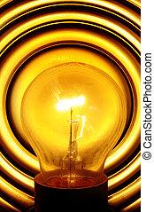 light bulb turned on - a light bulb turned on in a lamp