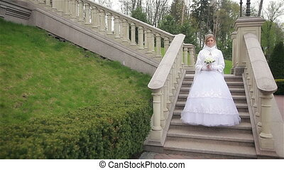 Beautiful bride in a wedding dress posing. Full HD