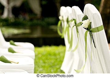 flower decoration chair at wedding venue on the beach