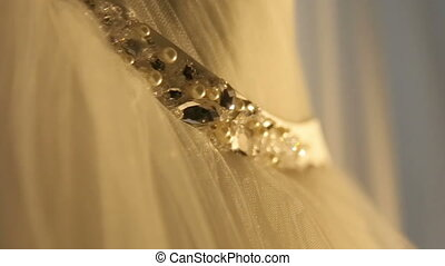 Beautiful stylish weeding dress with diamond belt close up...