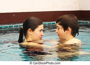 brother and sister portrait in the swimming pool