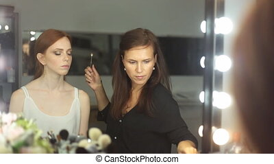Make-up artist doing make-up - Beautiful Woman Make-up...