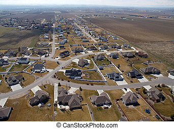 Midwest Suburbia Aerial - Modern suburban homes and farm...