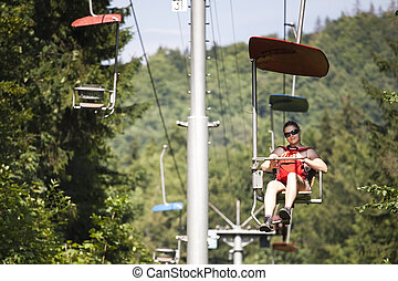 woman on chairlift in Dedinky, Slovak Paradise