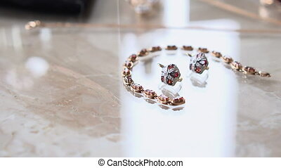 Women's jewelry on a table - Women's jewelry on a marble...