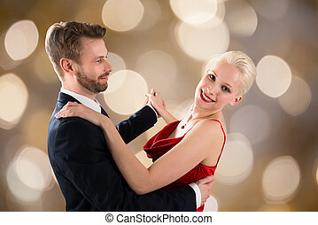 Young Couple Dancing On Bokeh Background - Portrait Of Young...