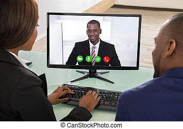 Businesspeople Having Videoconference - Two Businesspeople...