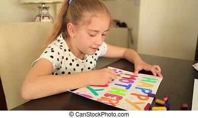 Cute girl drawing for mum - Child drawing of her mother for...