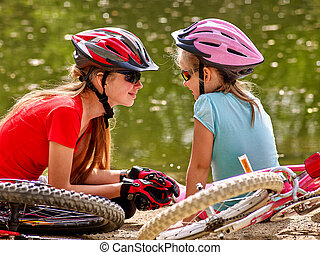 Bikes cycling family Happy mother and daughter rides bicycle...