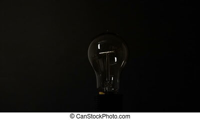 Light bulb turning around - New vision Electric light bulb...