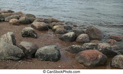 Boulders on the riverbank - Round Boulders on the banks of...