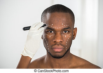 Persons Hand Drawing Correction Lines On Mans Face -...